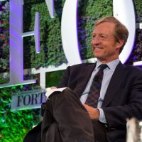 Tom Steyer, middle-aged billionaire with full head of hair, smiling as he participates in the 2013 Fortune Brainstorm Green forum