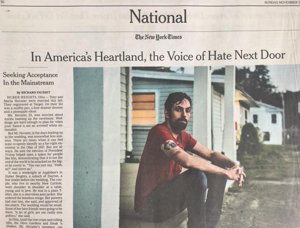 """Photo of part of page A16 of the November 26, 2017, issue of the New York Times, which features a story titled """"In America's Heartland, the Voice of Hate Next Door,"""" by Richard Fausset and includes a color photo of the story's subject, neo-Nazi Tony Hovater"""