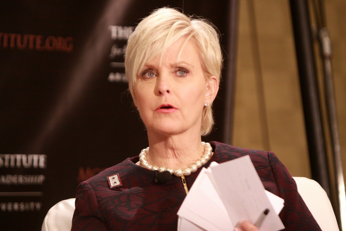 color photo of Cindy McCain, wife of U.S. Senator John McCain and a member of the Human Trafficking Advisory Council of the McCain Institute, speaking at an institute event in 2013