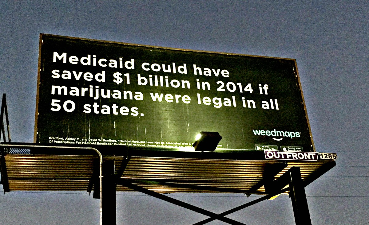 """Weedmaps billboard with black background and white text that reads: """"Medicaid could have saved $1 billion in 2014 if marijuana were legal in all 50 states."""""""