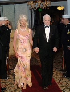 U.S. Sen. John McCain of Arizona and his wife Cindy pass through Navy Sideboys as they arrive for the 21st annual Coronado Salute to the Military Ball held at Hotel Del Coronado hotel, in Coronado, California, in 2006