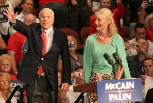 Color photo of John and Cindy McCain standing at a McCain/Palin podium during a September 15, 2008, stop in Jacksonville, Florida, on the presidential campaign trail.
