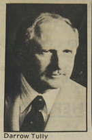 "screenshot of a clipping of a small black-and-white head shot of Darrow ""Duke"" Tully wearing jacket and tie"