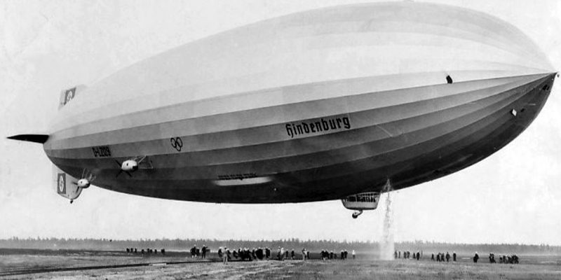 Photo of the Hindenburg preparing to land at Lakehurst, New Jersey following its first transatlantic flight. Hydrogen gas is being released by the airship in preparation for the landing; this can be seen on the ship's front right side.