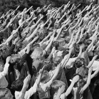 A 1942 photo from Southington, Connecticut, depicting the Bellamy salute. Francis Bellamy prescribed its use to accompany recital of the Pledge of Allegiance, which he authored in 1892. The salute fell out of favor during the Second World War because it was identical to the Nazi salute.