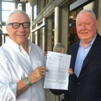color photo of Front Page Confidential cofounders Michael Lacey (left) and Jim Larkin, taken in the summer of 2017