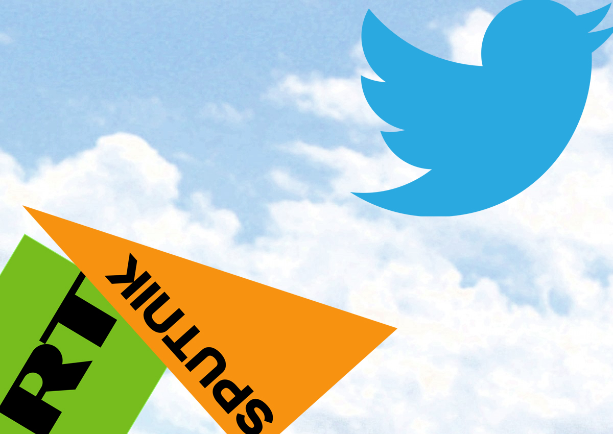 collage illustration of twitter logo appearing to fly away from Sputnik and Russia Today logos against a blue sky with puffy clouds