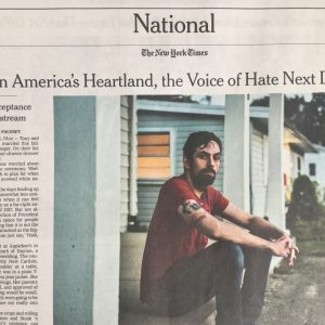 "Photo of part of page A16 of the November 26, 2017, issue of the New York Times, which features a story titled ""In America's Heartland, the Voice of Hate Next Door,"" by Richard Fausset and includes a color photo of the story's subject, neo-Nazi Tony Hovater"