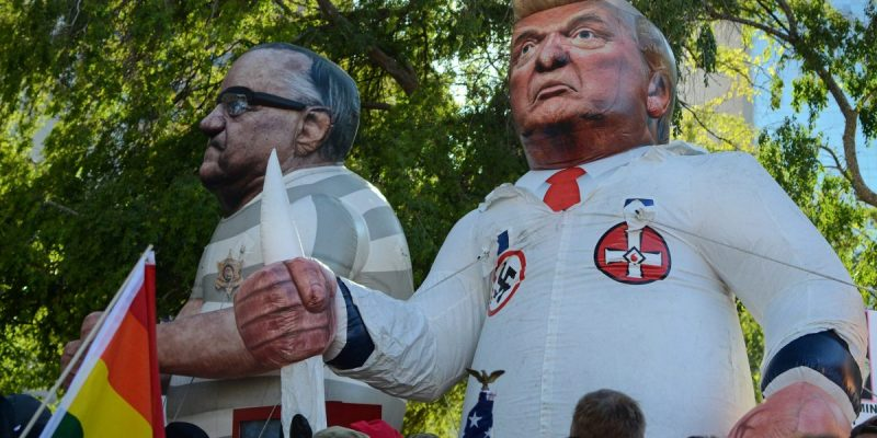 color photo of inflatable effigies of Joe Arpaio, former sheriff of Maricopa County, Arizona, and U.S. President Donald Trump, taken at a demonstration in Phoenix in the summer of 2017