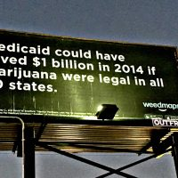 "Weedmaps billboard with black background and white text that reads: ""Medicaid could have saved $1 billion in 2014 if marijuana were legal in all 50 states."""