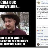 "Screenshot from Milwaukee County Sheriff's Office Facebook page, depicting a meme that shows a photo of a man in a cowboy hat (Dan Black) and the words ""Cheer up, snowflake...If Sheriff Clarke were to really harass you, you wouldn't be around to whine about it."""