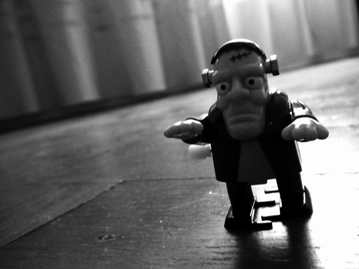 black-and-white photo of a windup toy that resembles a Frankenstein monster