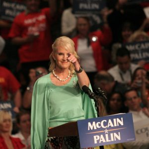 Color photo of Cindy McCain standing at a McCain/Palin podium during a September 15, 2008, stop in Jacksonville, Florida, on the presidential campaign trail.