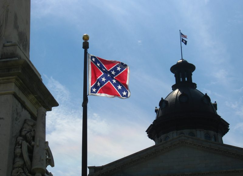 color photo of the Confederate flag flying on the grounds of the South Carolina statehouse. This photo was shot in 2008; the flag was not taken down until 2015 (https://www.washingtonpost.com/news/post-nation/wp/2015/07/10/watch-live-as-the-confederate-flag-comes-down-in-south-carolina/?utm_term=.7c8b5996b72e)