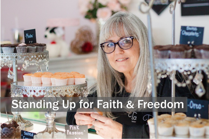 "color photo of Cathy Miller in her bakery, with text across the image that reads ""Standing Up for Faith & Freedom"""