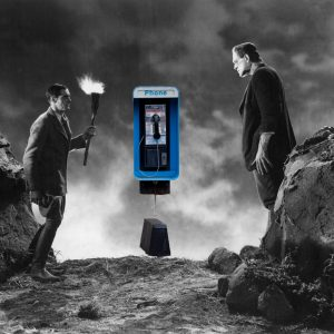 Photoshopped image of a black-and-white clip from Frankenstein (1931) depicting Colin Clive and Boris Karloff with a color image of a pay phone prominently placed in the background