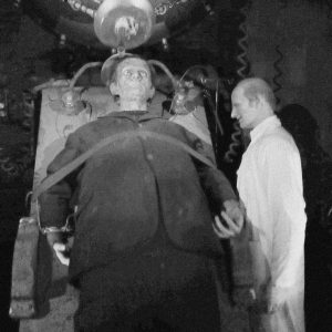 "grainy black-and-white image of ""Dr. Frankenstein and His Creature,"" an exhibit at Movieland Wax Museum in Niagara Falls, Canada"
