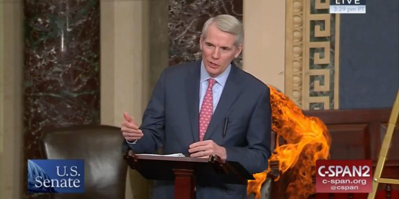 Color screenshot of Rob Portman addressing the U.S. Senate with flames shooting out of his ass. Entirely fake.