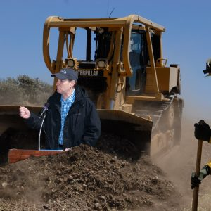 Photoshopped image depicting U.S. Senator Ron Wyden in a dirtpile in front of a bulldozer being driven by Frankenstein. (Really.)