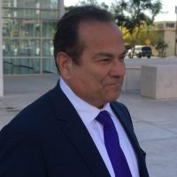 color photo of criminal defense attorney Paul Cambria of Buffalo, New York, in suit and tie, standing outside a federal courthouse in Phoenix, Arizona, on Wednesday, April 11, 2018