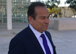 color photo of criminal defense attorney Paul Cambria in suit and tie