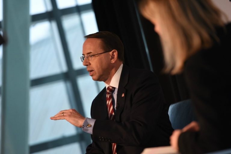 Color photo of Deputy U.S. Attorney General Rod Rosenstein, seated, in suit and tie, headlining the keynote event at the Internet Education Foundation's January 2018 State of the Net Conference