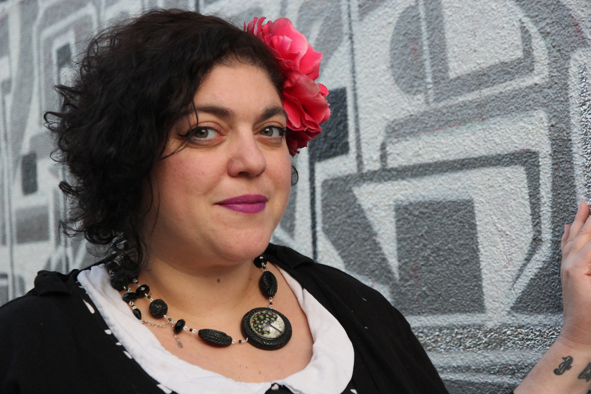 photo of Fresno State University faculty member Randa Jarrar with a flower in her hair, used with permission of the photographer, Adela Santana