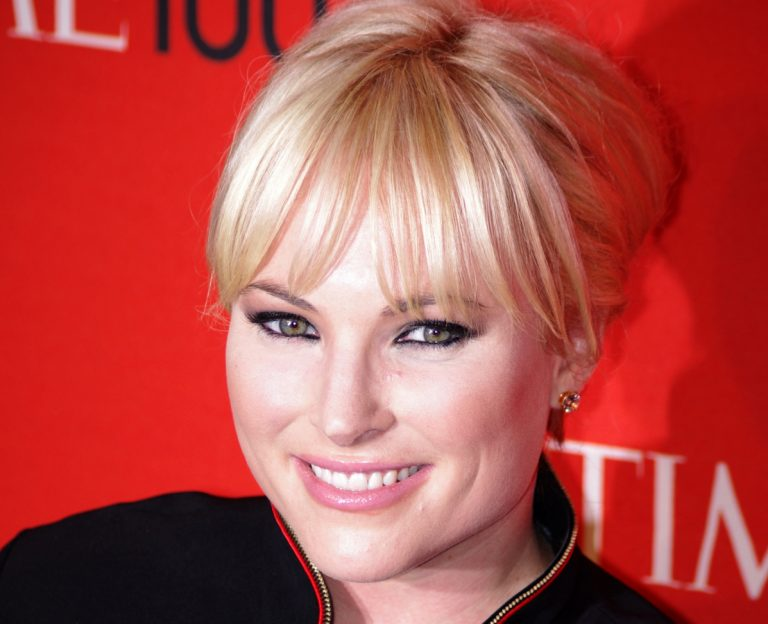Color headshot of Meghan McCain looking into the camera, hair pulled back, smiling.