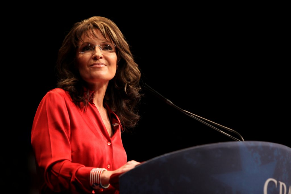 Photo of Sarah Palin at a lectern looking off into the distance.