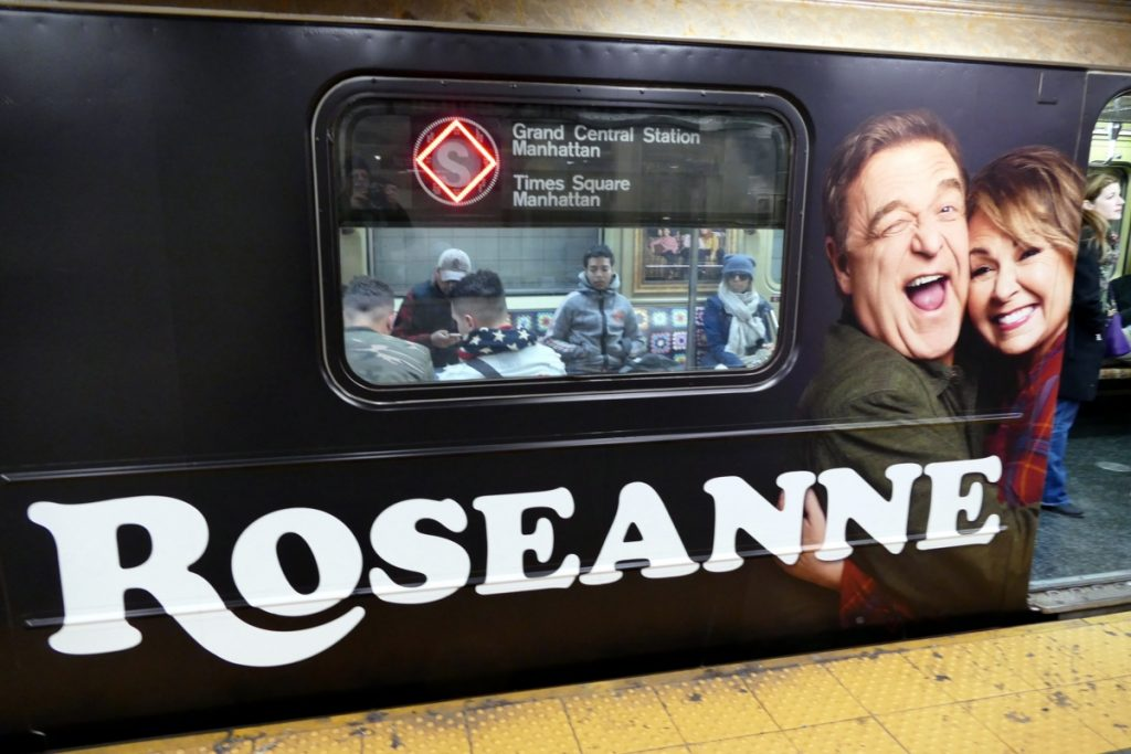 New York subway car wrapped with an for the Roseanne TV show.