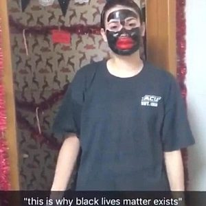 Photo of a teenage white girl in blackface with big fake lips.