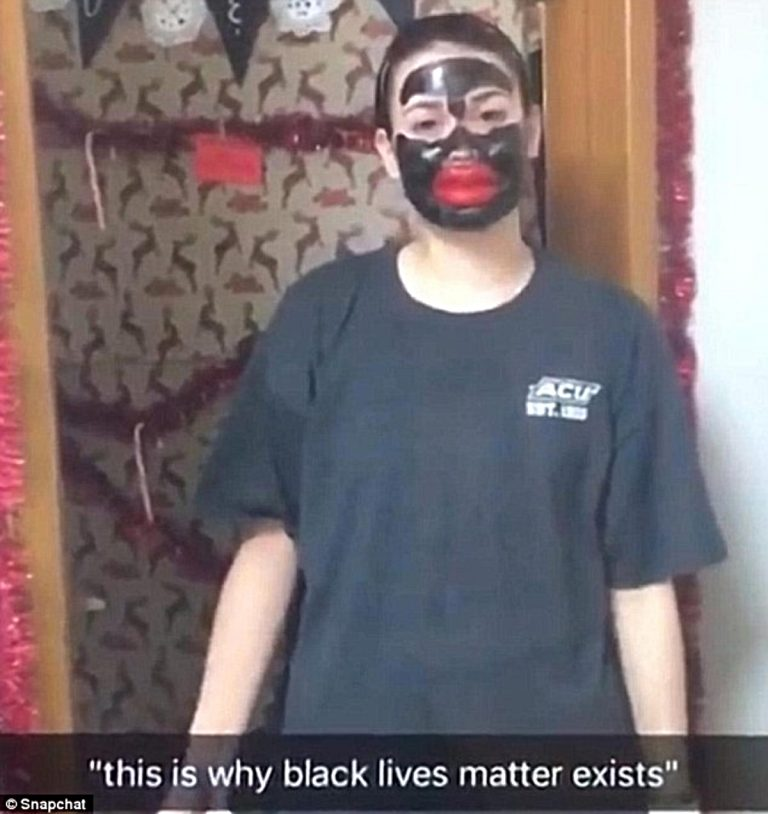 Photo of a teenage white girl in blackface with big fake lips.