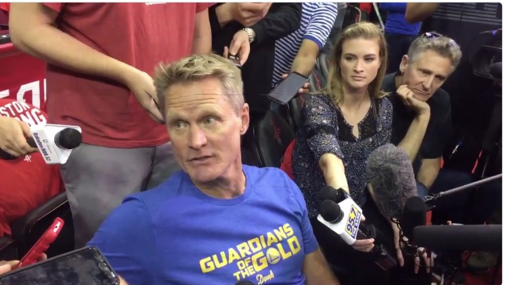 screenshot of Golden State Warriors head coach Steve Kerr speaking to reporters about the NFL's new policy requiring players to stand during the playing of the national anthem, May 24, 2018
