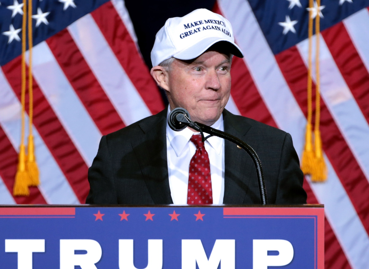 Photo of Jeff Sessions at a podium during a Trump rally
