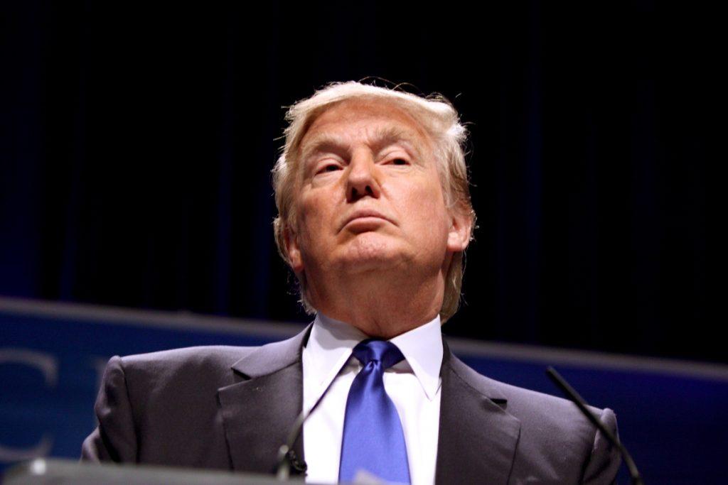 Photo of Donald Trump at a lectern.
