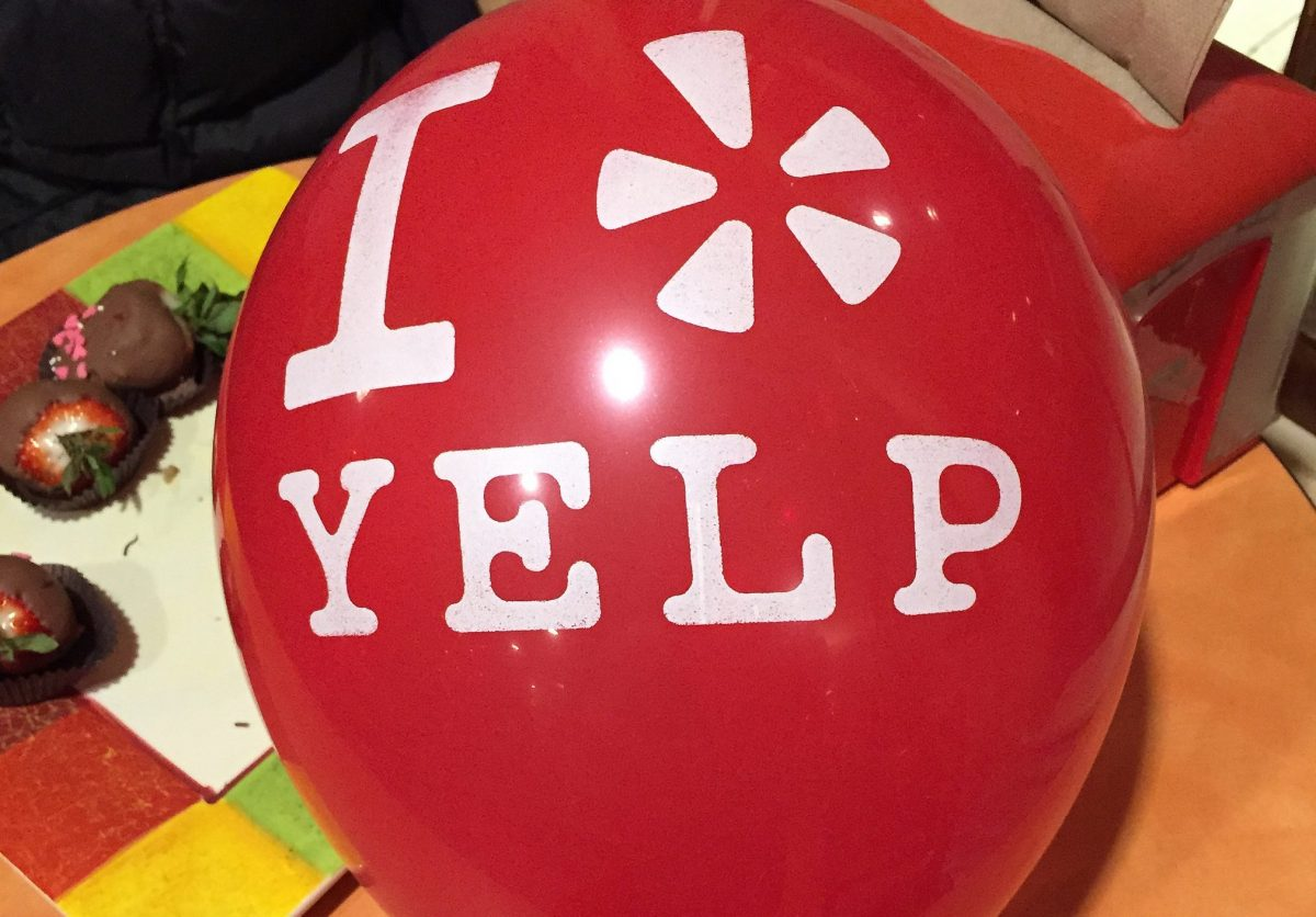 photo of a red balloon with white type that reads 'I * Yelp', in which the * is Yelp's trademarked star icon