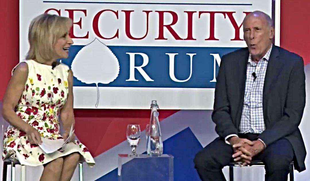NBC news anchor Andrea Mitchell, smiling, interviews Dan Coats, the Trump administration's director of national intelligence, onstage at the 2018 Aspen Security Forum