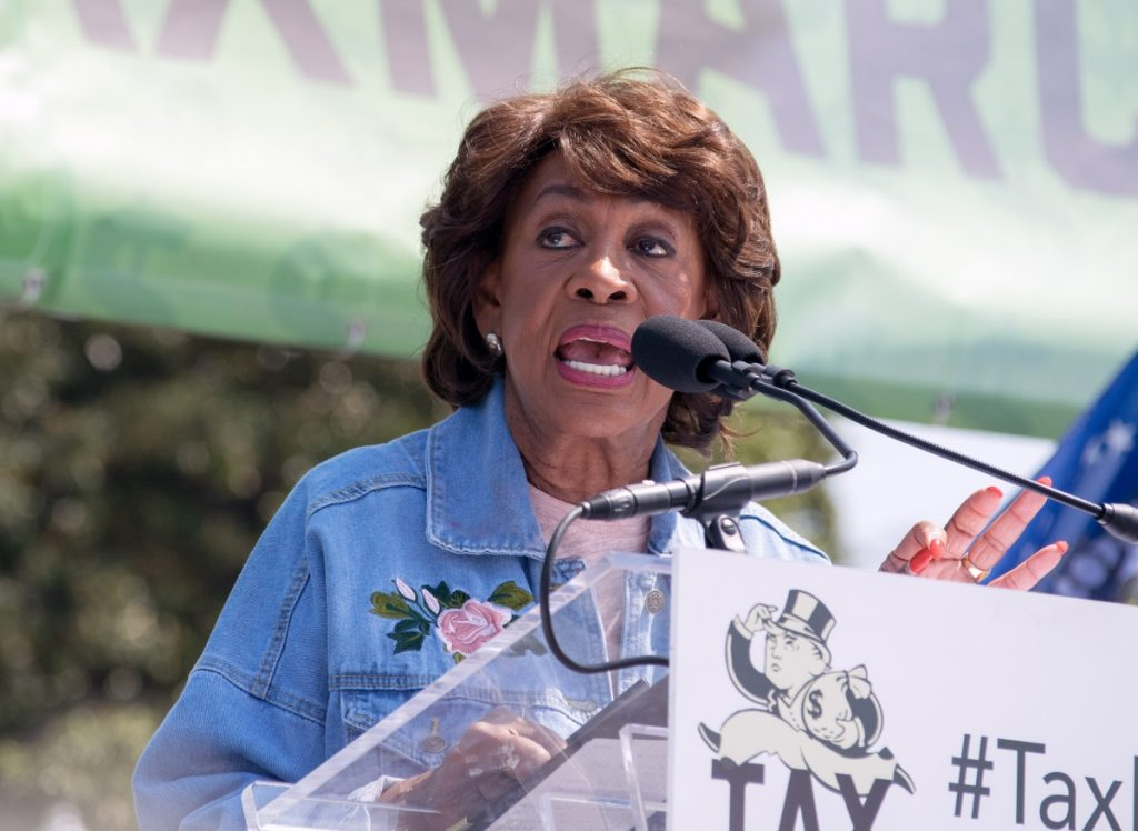 Photo of Maxine Waters speaking at a podium.