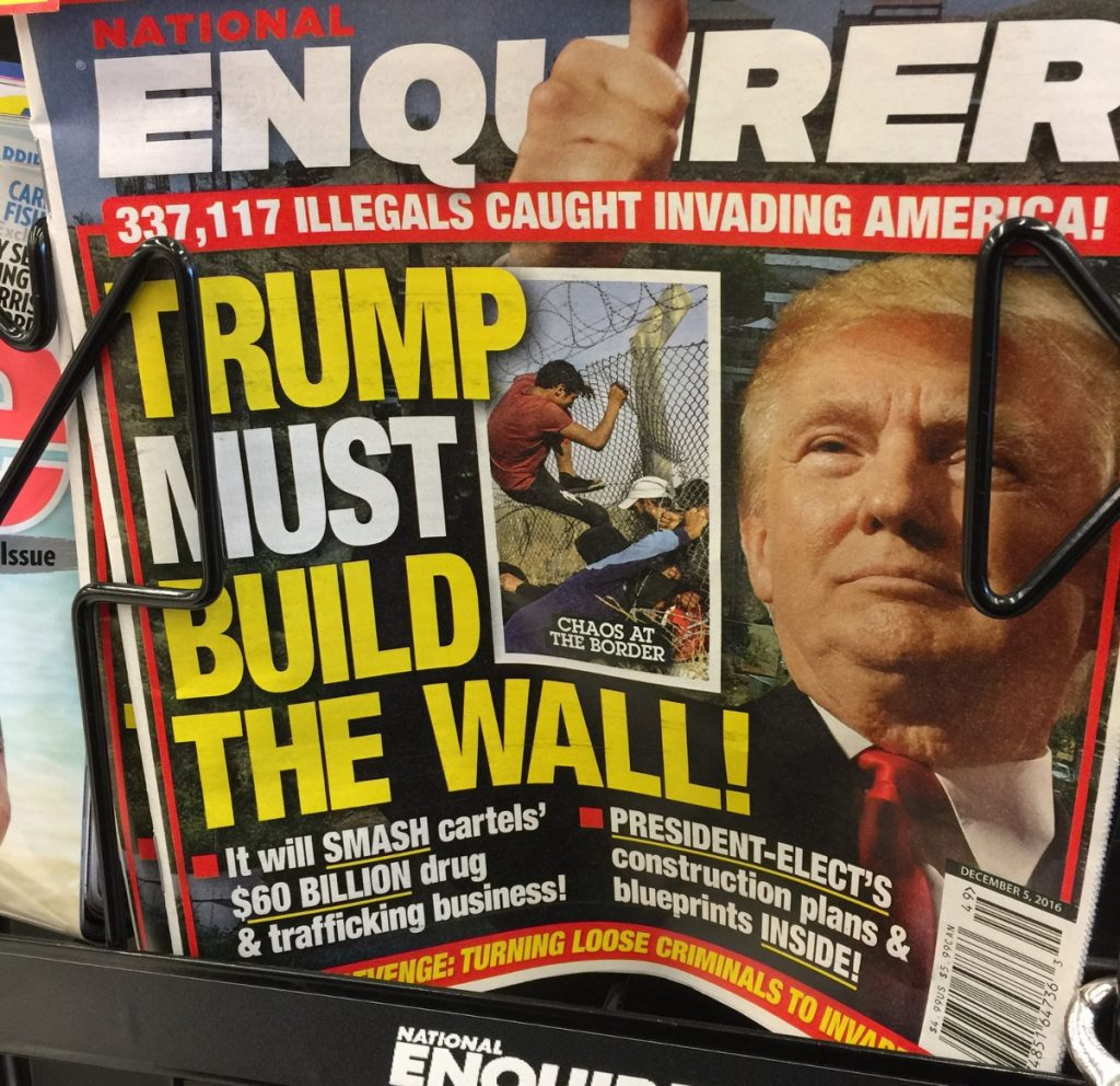 Photo of National Enquirer tabloid in a rack at supermarket.