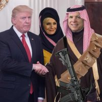 News photo altered to appear to depict President Donald Trump shaking hands with John McCain, who appears with his head covered by a red-checkered Saudi ghutra, with an automatic rifle and bandolier strapped to his chest. Cindy McCain is in the background, sporting a burqa