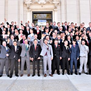color portrait of about 100 young men, members of the Class of 2019 at Baraboo High School in Wisconsin, giving a Nazi salute as they're being photographed in the spring of 2018 on the occasion of their junior prom