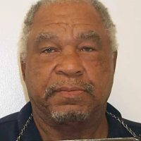 Head-on color mugshot of confessed serial killer Samuel Little