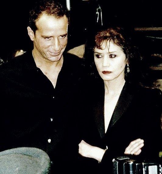 High-contrast photo of fashion designer Lloyd Klein and actress Maria Schneider.