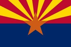 Image of the Arizona state flag, which depicts a five-pointed orange star in the center, against a royal blue field on the lower half and alternating red and yellow rays that emanate to the edges above