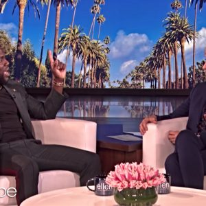 Kevin Hart and Ellen DeGeneres, seated and talking, on the set of The Ellen Show.