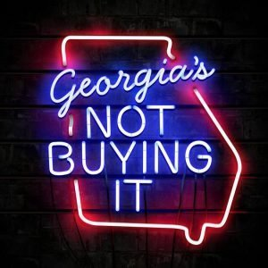 color image of a neon sign that reads 'Georgia's NOT BUYING IT,' surrounded by neon tubing in the shape of the state of Georgia