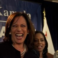Kamala Harris laughing at a campaign event.