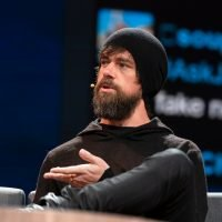 Twitter CEO Jack Dorsey seated, speaks at TED.