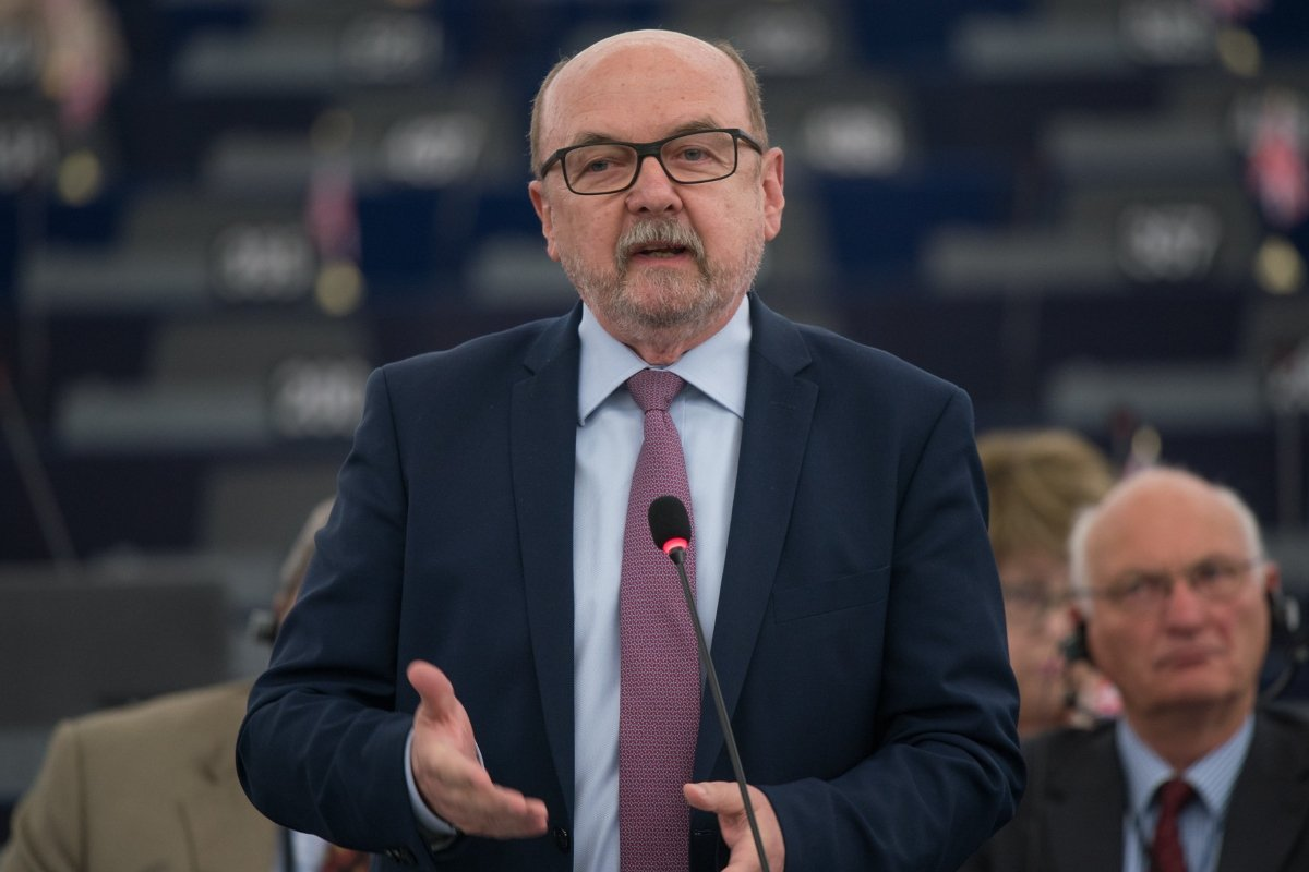 Polish MEP speaking at a microphone.