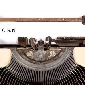 Typewriter with word PORN typed out.